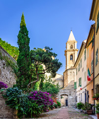 The yard with many flowers in the ancient town of Ventimiglia. Italy.