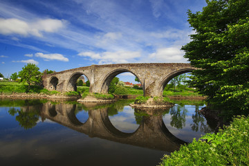 StirlingoOld bridge with arches, turrets and buttresses crosses the Forth river. Scotland,