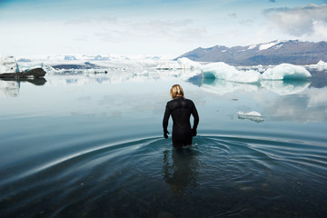 Man in wetsuit, stood in cold water, Iceland, Europe