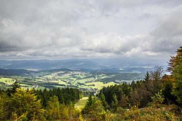 View over the bavarian forest with dark clouds