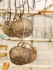 Wicker baskets hanging under ceiling