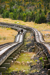 Tracks of the cog railway with workers