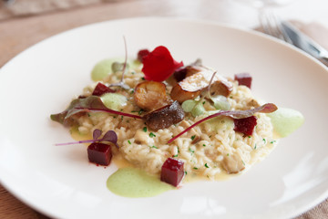 Risotto with fried porcini mushrooms on plate