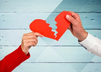 Hands of couple holding a broken heart