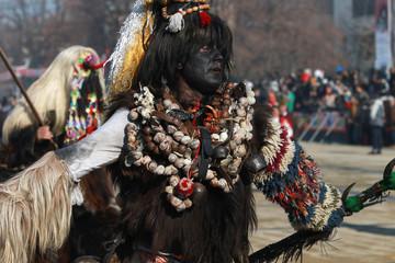Pernik, Bulgaria - January 28, 2017: Masquerade festival Surva in Pernik, Bulgaria. People with mask called Kukeri dance and perform to scare the evil spirits.