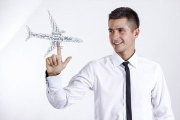 Travel by Plane - Young businessman touching word cloud