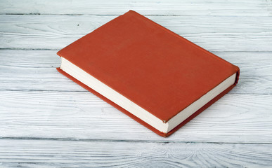 Blanc book cover on textured wooden background.