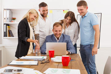Happy business people team together have fun in office