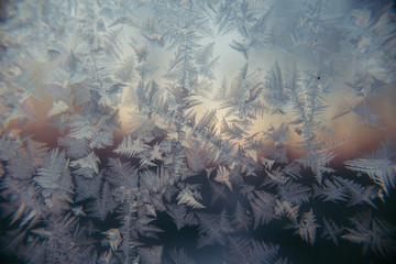 hoarfrost at a window against the background of decline dawn