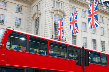 London Bus and UK flags in Piccadilly Circus