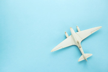 Miniature toy airplane on blue background