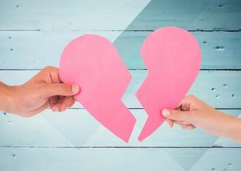Hands of couple holding broken heart