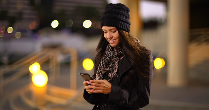 Millennial white girl texts her friends in the city