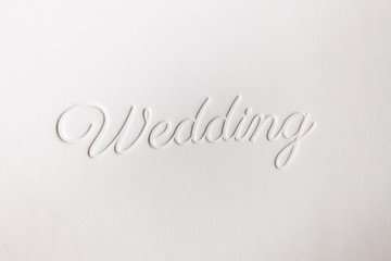 "Logo wedding book and the word ""Wedding"" supplanted on the leather cover"