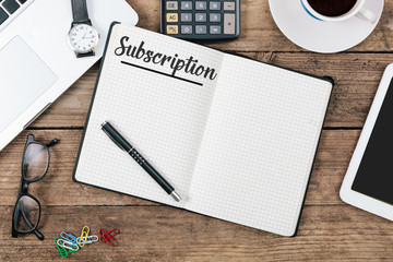 Subscription written in note pad