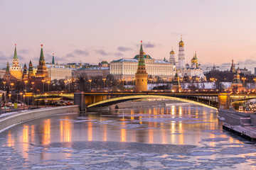 Aluminium Prints Asian Famous Place Illuminated Moscow Kremlin and Moscow river in winter morning. Pinkish and golden sky with clouds. Russia