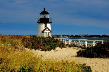 Nantucket Island, Massachusetts - October 12, 2008:   Branch Point lighthouse capped by a single fresnel light encased in a black cupola sits on a sandy island