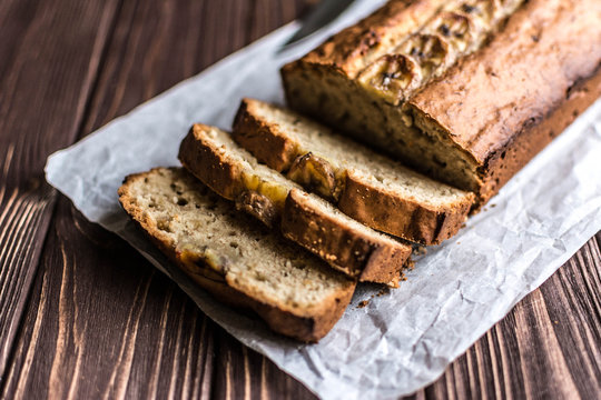 Homemade banana cake on a wooden background