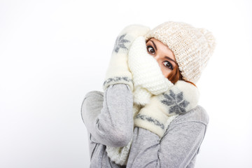 Young girl in a woolen hat and scarf.