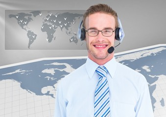 Portrait of smiling businessman with headset in office