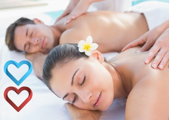 Couple receiving massage in spa