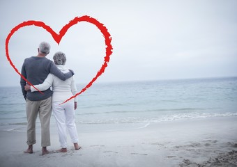 Senior couple embracing each other at beach