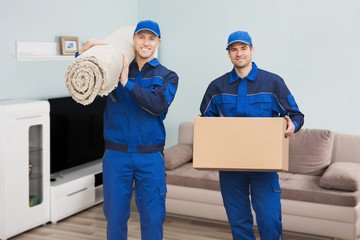 Two Male Movers Standing In House