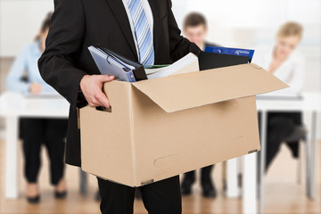 Businessperson Carrying Cardboard Box