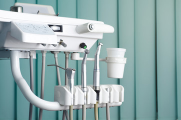 Dental drills, dental equipment , teal background