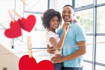 Portrait of happy couple showing new home key