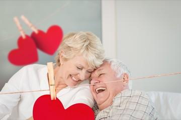 Senior couple embracing on sofa