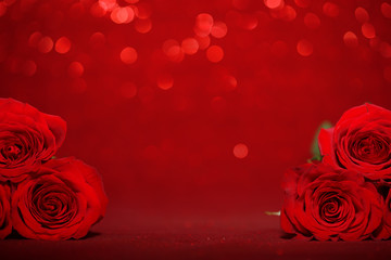 Beautiful red roses on sparkling red background