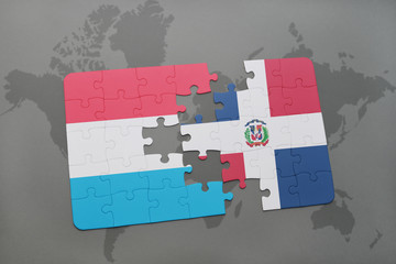 puzzle with the national flag of luxembourg and dominican republic on a world map
