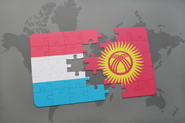puzzle with the national flag of luxembourg and kyrgyzstan on a world map