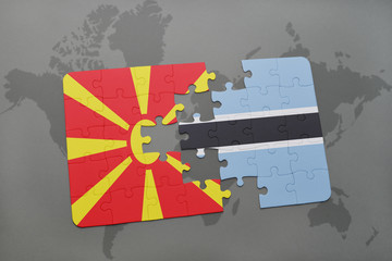 puzzle with the national flag of macedonia and botswana on a world map