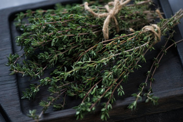 Close-up of two bunches of fresh thyme, selective focus