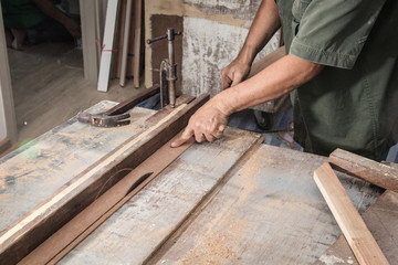 wood workshop with handcraft tools and raw wood on construction