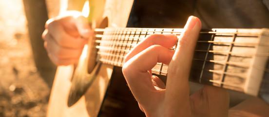 Hand playing guitar