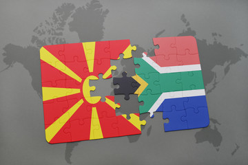 puzzle with the national flag of macedonia and south africa on a world map