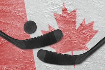 Canadian flag and two hockey sticks hockey