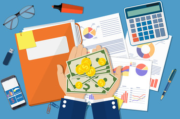 hands with money and folder with financial reports