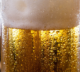 alcohol drink beer on macro picture with sparkles and foam useful for background