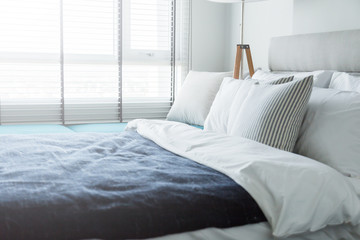 Bed maid-up with clean white pillows and bed sheets in beauty ro