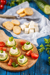 Healthy mini sandwiches with cucumber and feta cheese