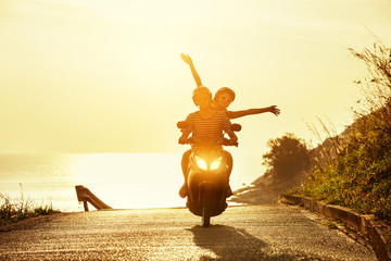 Happy couple travel motorcycle sea road