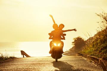 Happy couple travel motorcycle sea road