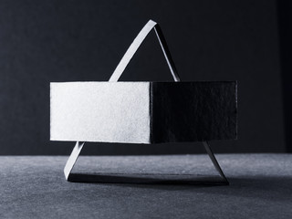 Dark paper shapes and shadows with dark paper background