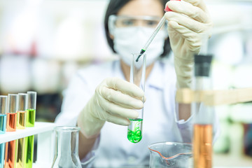 Female scientist researching in laboratory
