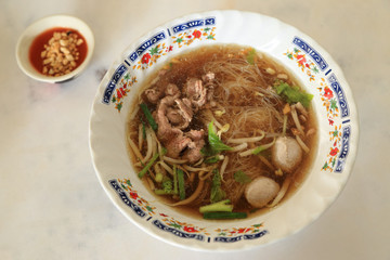 Asian rice noodle recipe with meat and meatball.