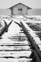 Old, rural railroads and railway station in winter time